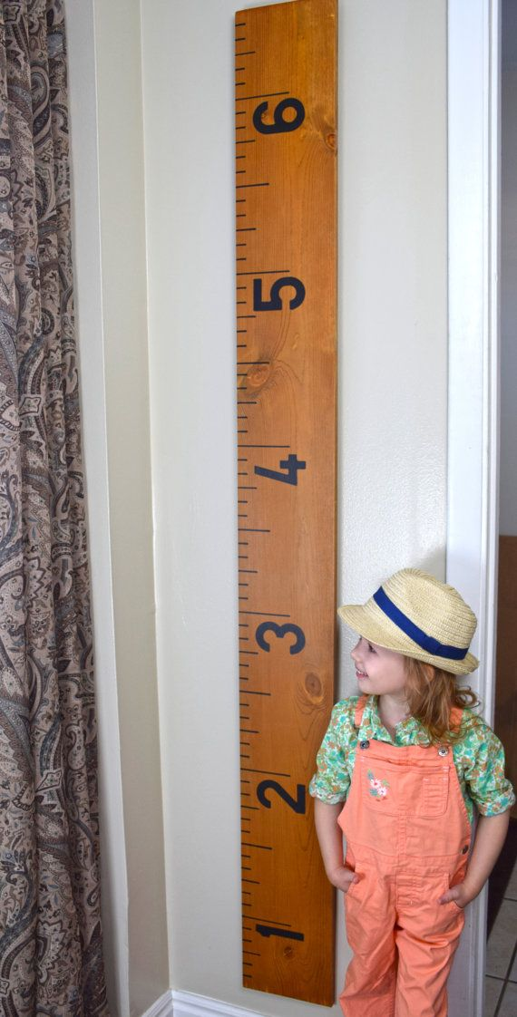 This is a handmade rustic giant ruler growth chart stained in our