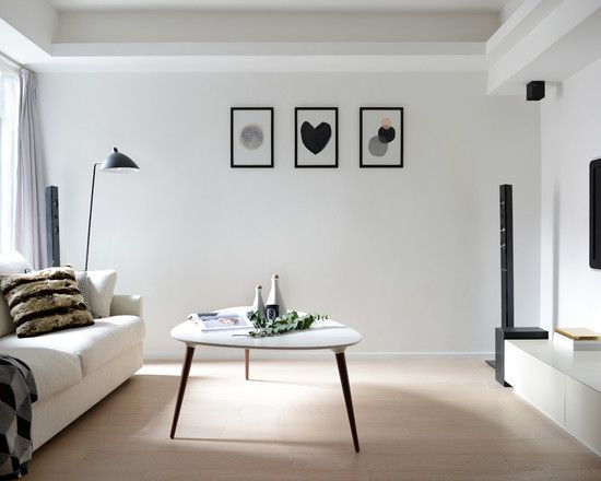 Interior Design, Charming Contemporary Black And White Living Room Ideas Also White Couch Color Also White Triangle Coffee Table Shape Also Beige Laminate Floor Also Cool Black Floor Lamp Also Black And White Picture Theme On Wall: Tips in Applying Black and White Living Room Ideas