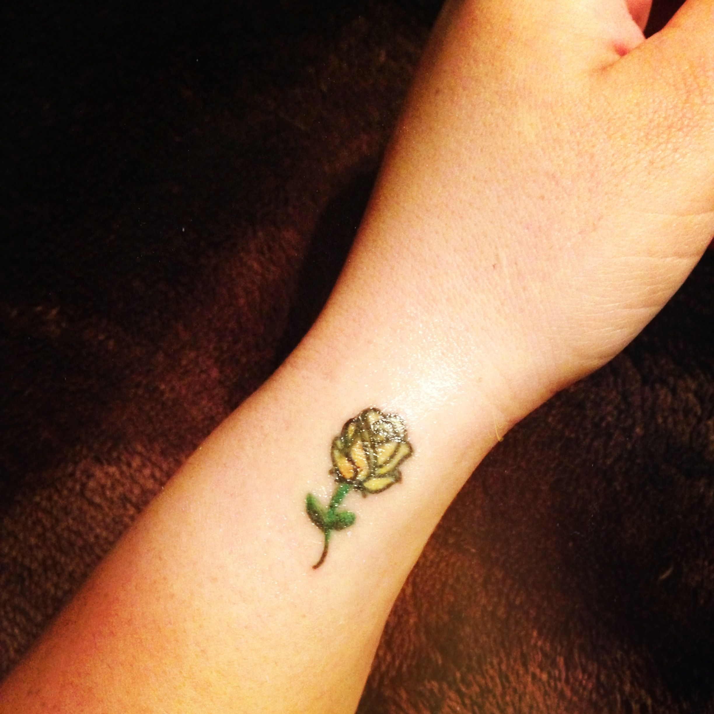 Small yellow rose tattoo Yellow rose tattoos, Small rose