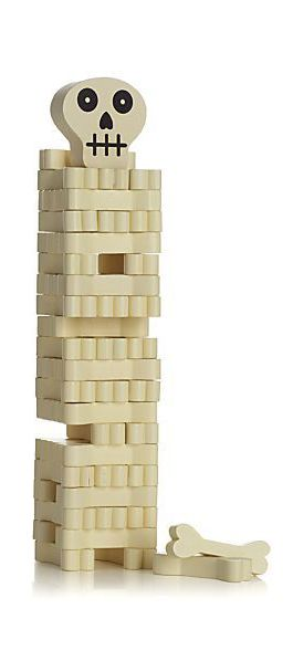 Stack the bones if you dare. Fun stacking game challenges you to remove a bone from the bottom and restack it on top without toppling over the tower. Includes painted wood blocks shaped like bones, instructions and a cute skull to set on top of the stack.