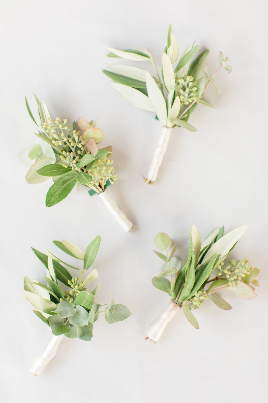 Beautiful italian olive branch boutonnieres for a wedding