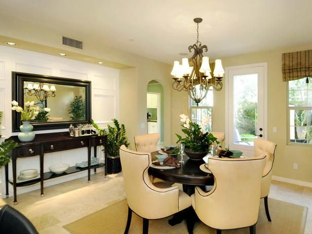 Elegant Dining Room: This formal dining room, positioned between the kitchen and courtyard, features dark espresso-colored furniture for an elegant look. From HGTVRemodels.com