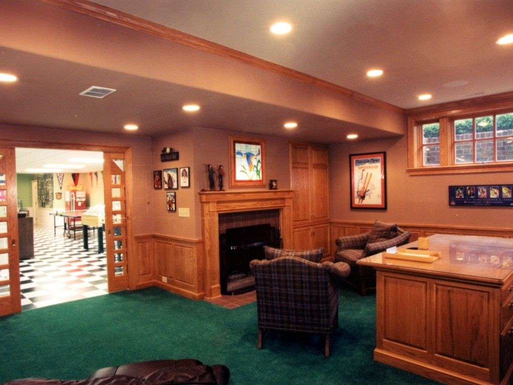 Basement Office Design Property basement office with fireplace, enlarged window, and wainscot