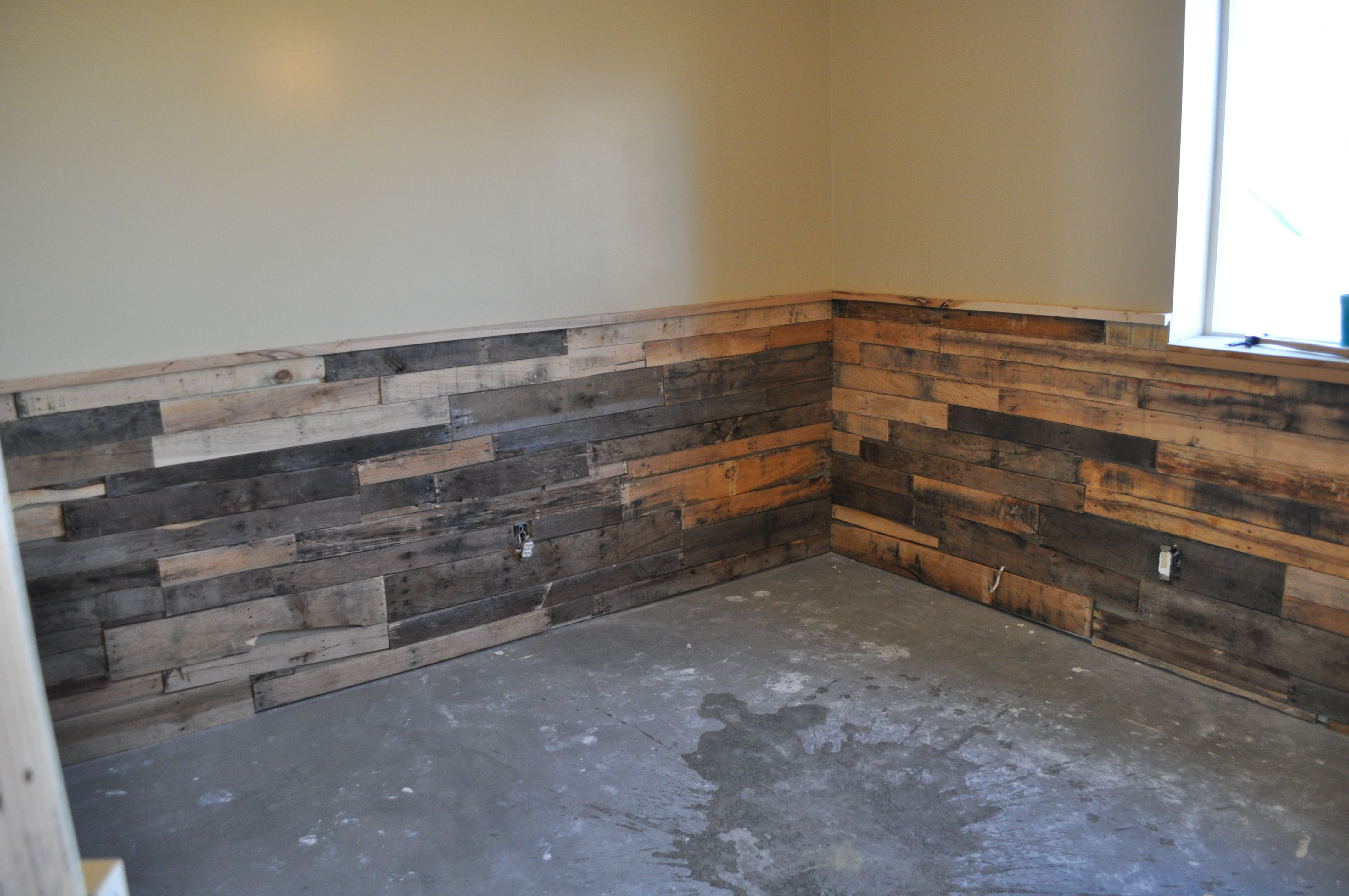 Bottom half of the walls to the right when you walk in for Using pallets for walls