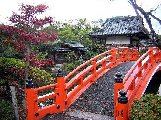 red bridge in Kyoto. actually shrine gates or bridges are vermilion 朱色