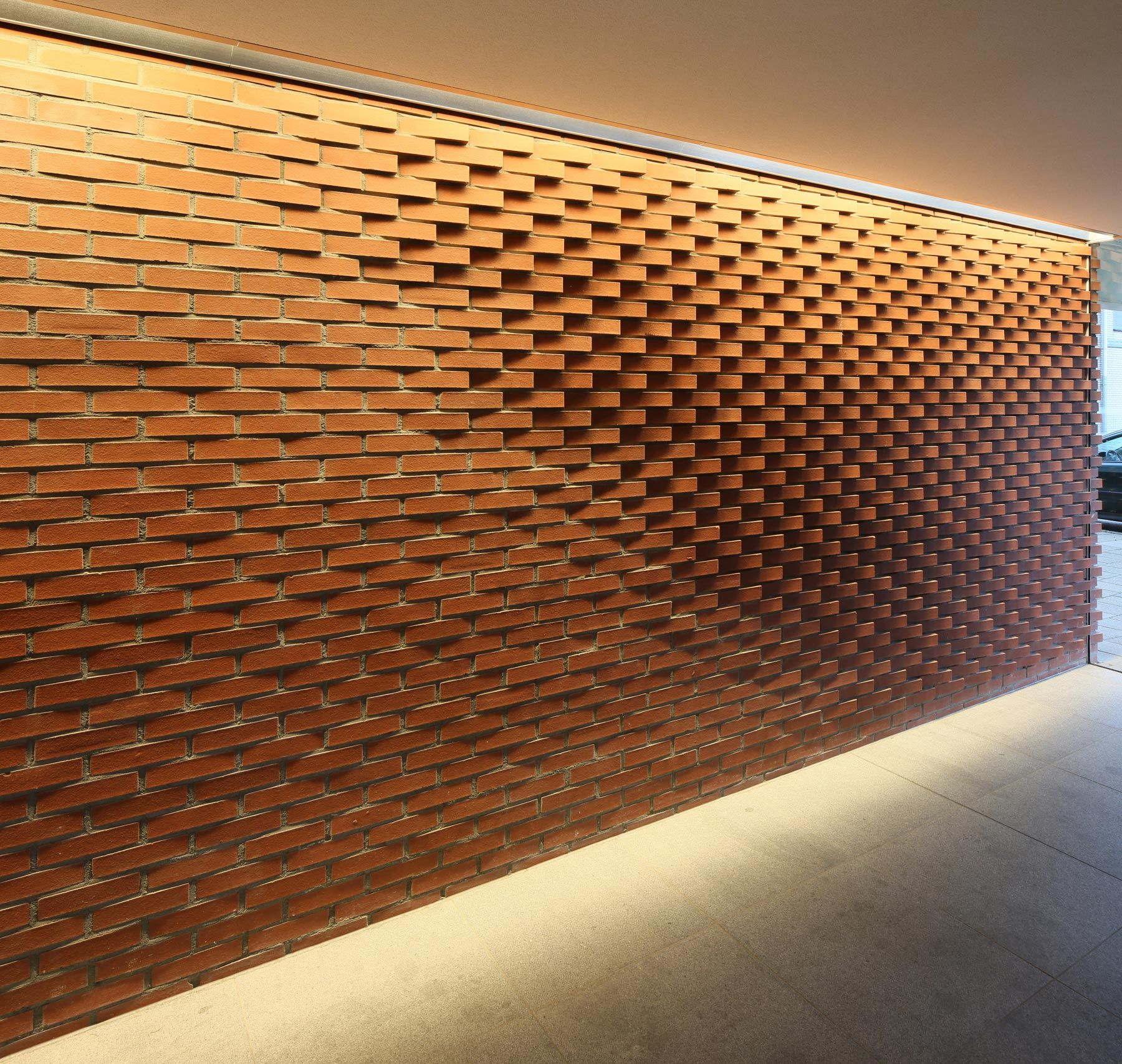creative way to make a brick wall more interesting by adjusting the direction of the - Brick Design Wall