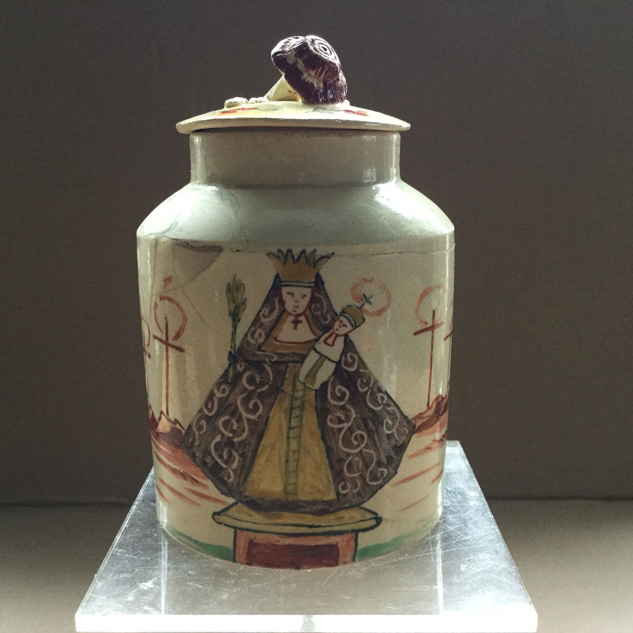 Tea container terrible damaged  the container is english , But painted in Holland:the Madonna from Kevelaar.The lid is not original.