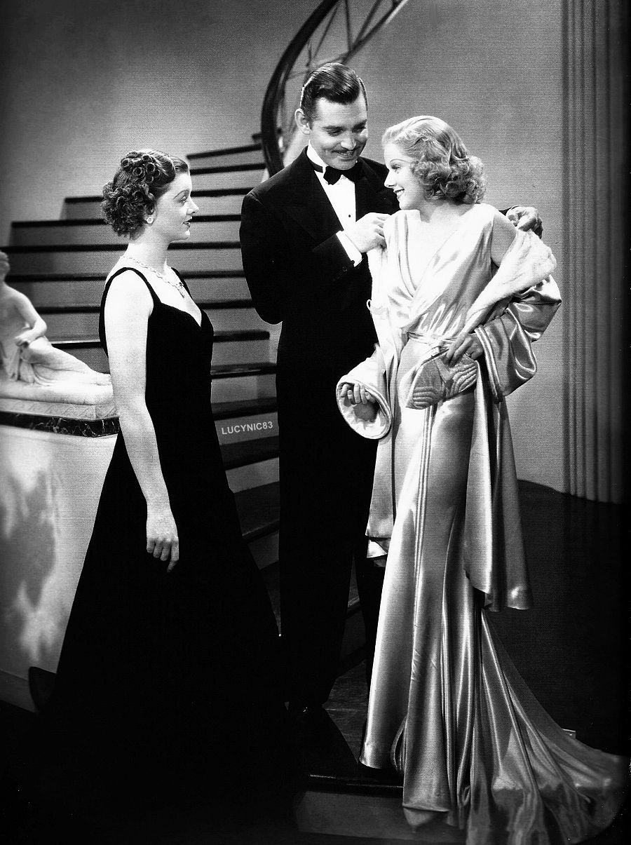 Jean harlow in a still from wife vs secretary with myrna loy and