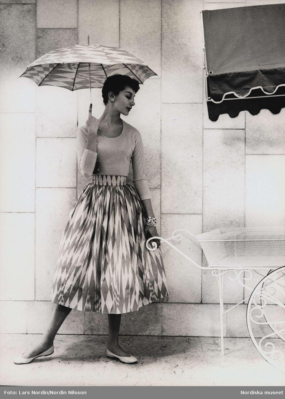 Kjol och parasoll av