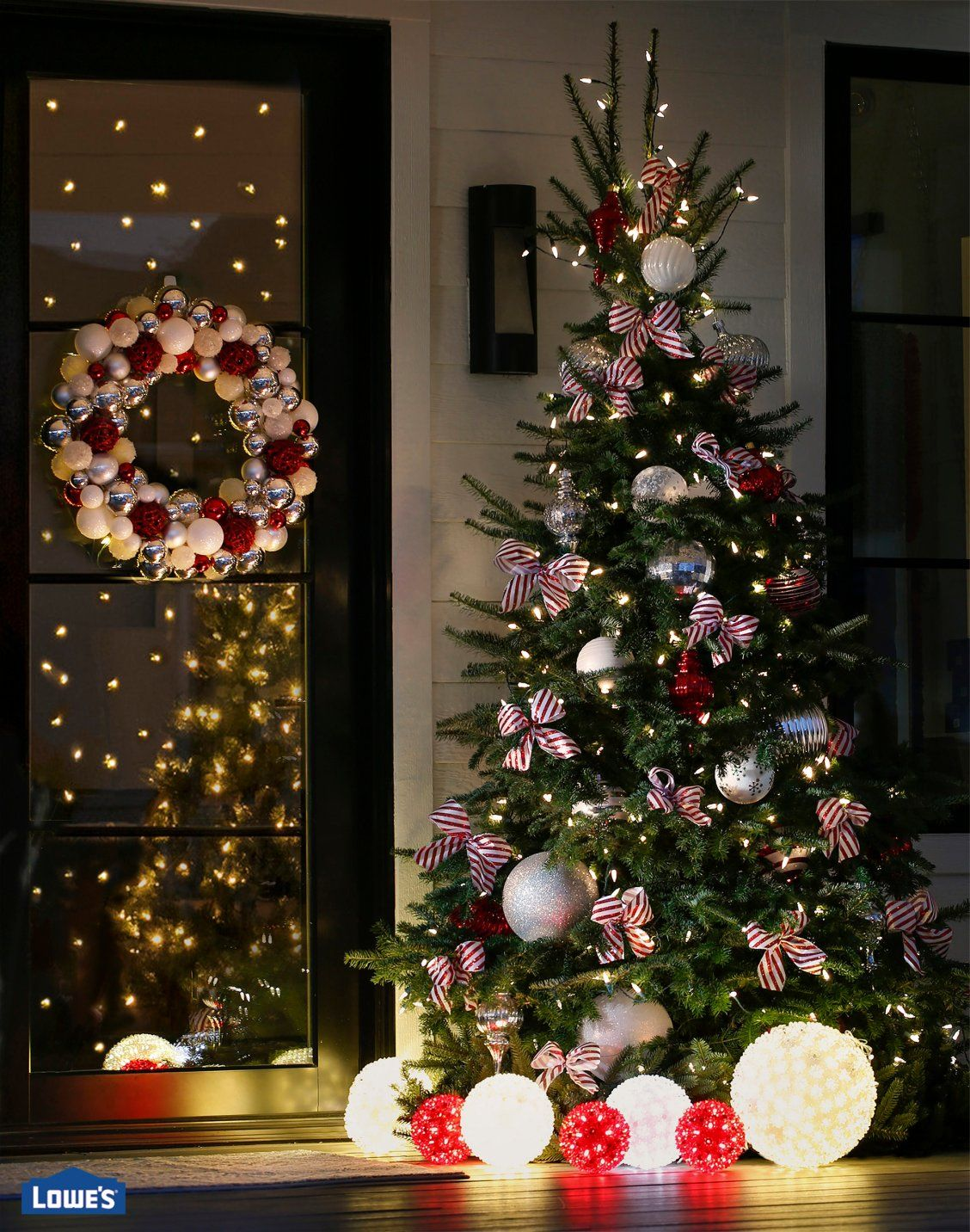 Sweeten Up Your Exterior Christmas Tree With Candy Cane Inspired Ribbons  And Oversized Ornaments In Red