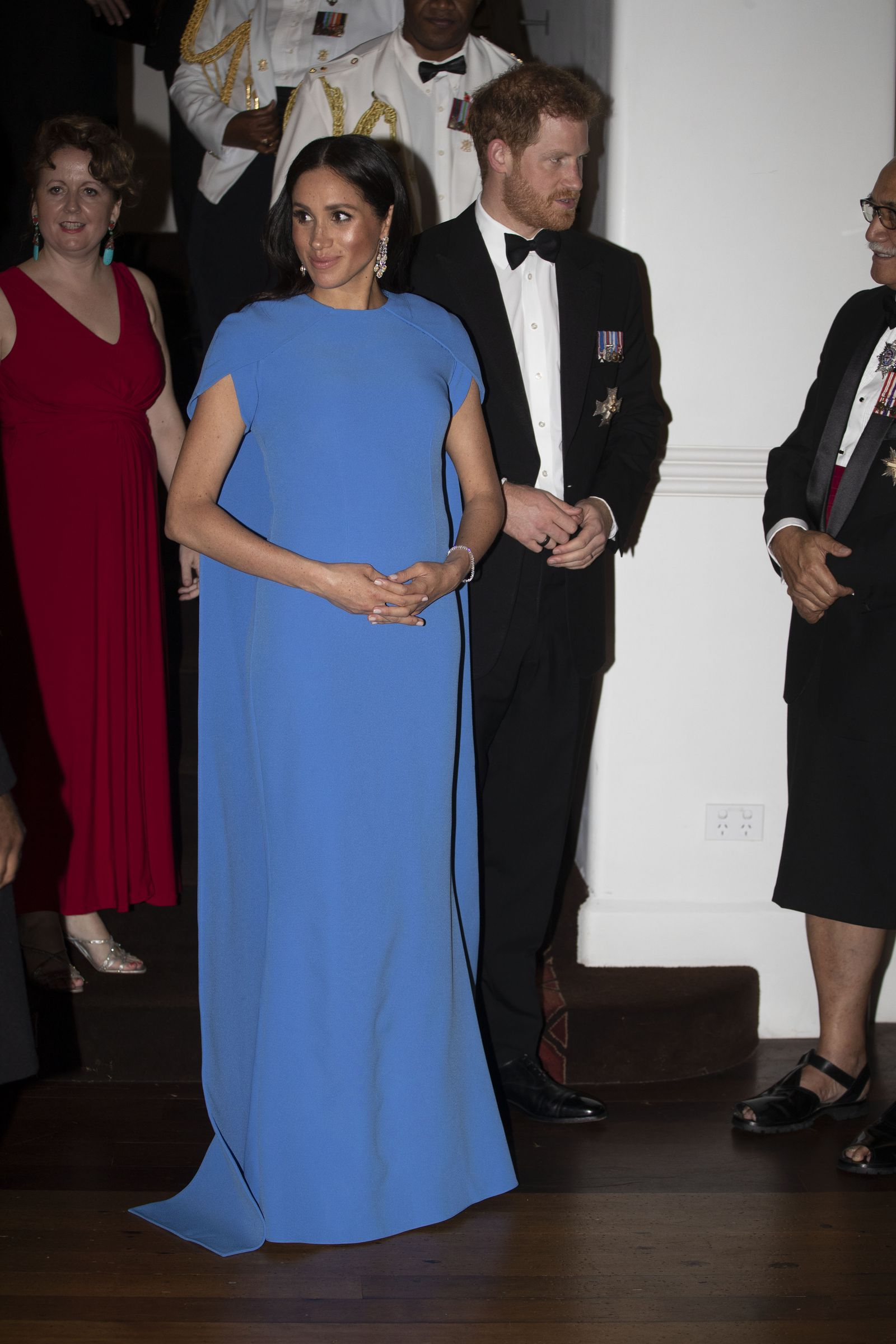 1cf1fcc12 Meghan Markle Wears an Elegant Blue Safiyaa Cape Gown for Her First State  Dinner as a Royal in Fiji