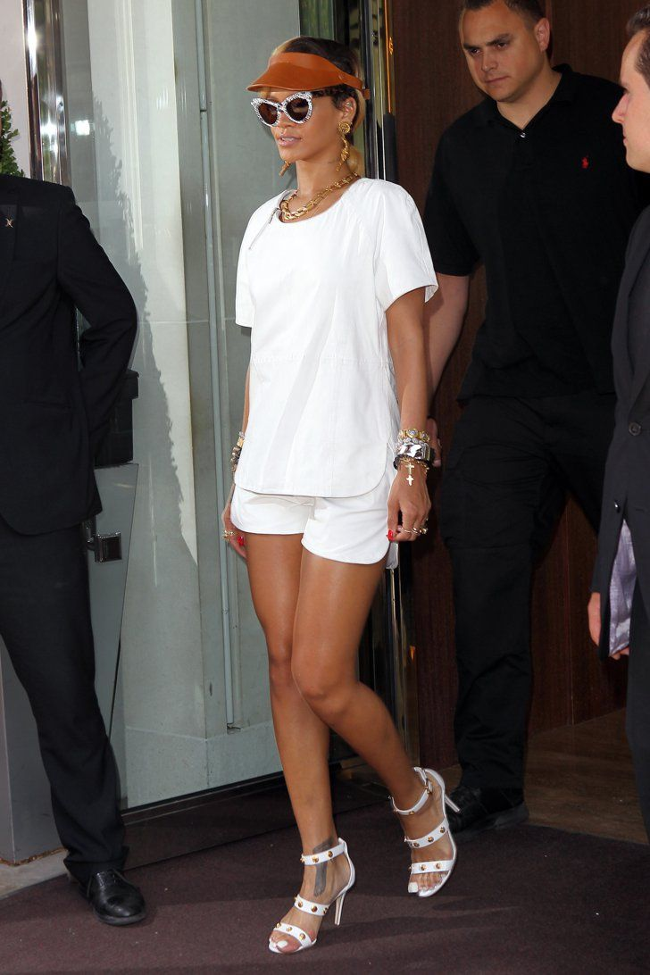 Pin for Later: A Tribute to Rihanna's Killer Street Style on Her 28th Birthday  An edgy spin on tennis whites, complete with an orange visor and bevy of mixed-metal jewels, had heads turning in London.