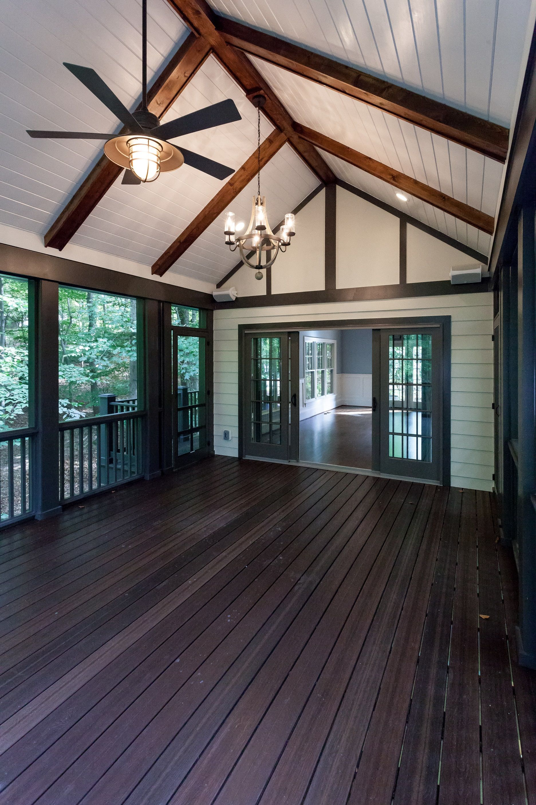Vaulted Ceiling Screen Porch With White Painted Wood Ceiling And Stained Beams In Custom Tudor Home By Bcn Ho Porch Interior Painted Wood Ceiling Wood Ceilings