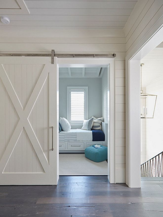 This white shiplap barn door opens to