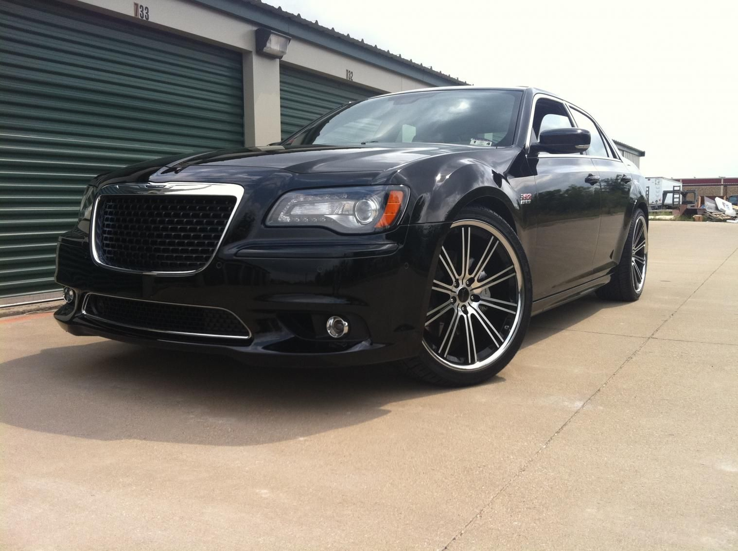 "2013 chrysler 300 srt8 on 30 inch wheels 22"" Savini"