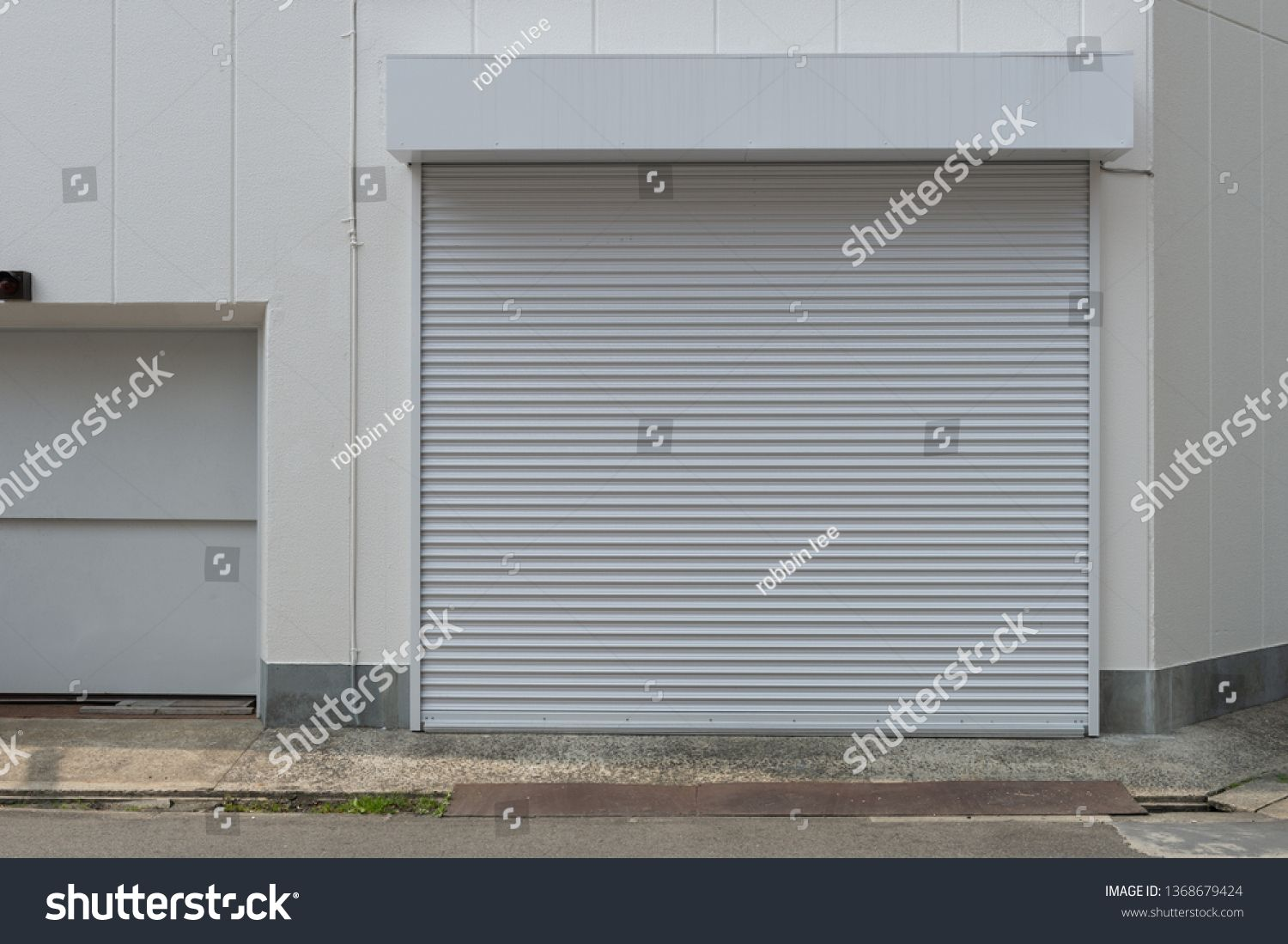 A Closeup Shot Of Automatic Metal Roller Door Used In Factory Storage Garage And Industrial Warehouse The Corrugated And Fol In 2020 Roller Doors Metal Sheet Doors