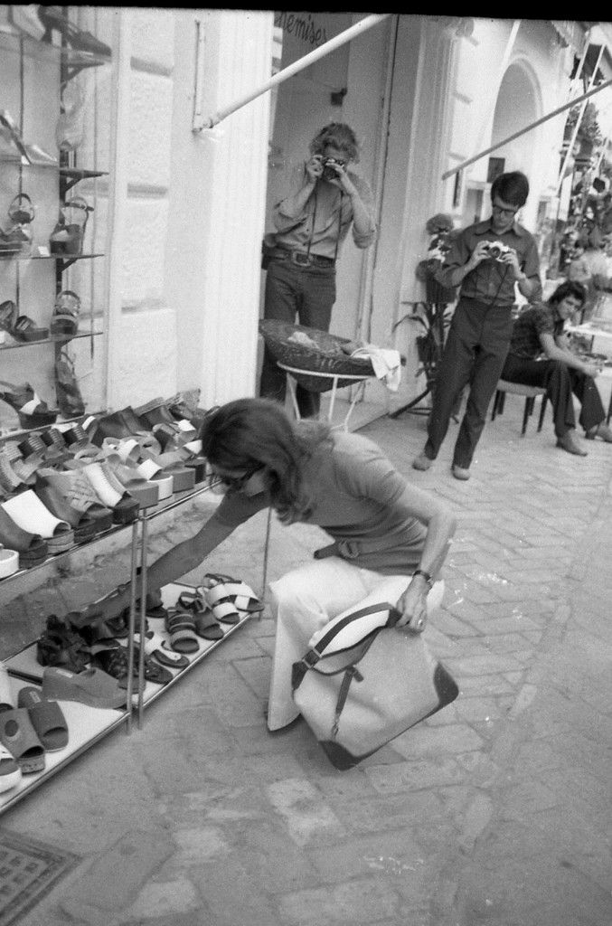 Jackie Kennedy Shoes: Jackie Trying To Look At Shoes And Two Jokers In