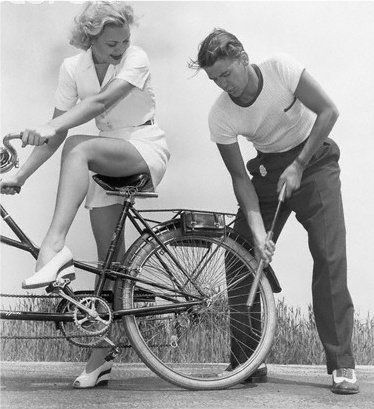 Jane Wyman awaiting Ronald Reagan to pump up the tire