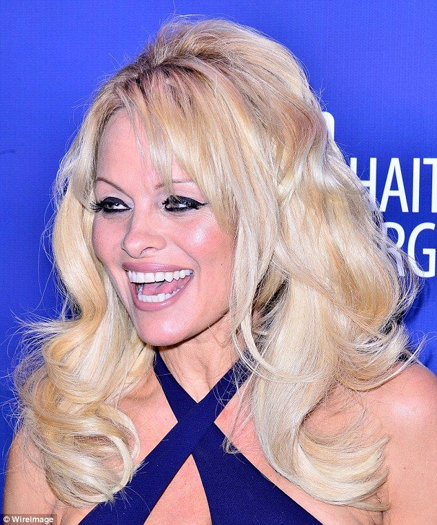 Bad bouffant: Pamela Anderson was seen sporting visible bonds at a gala event last week...