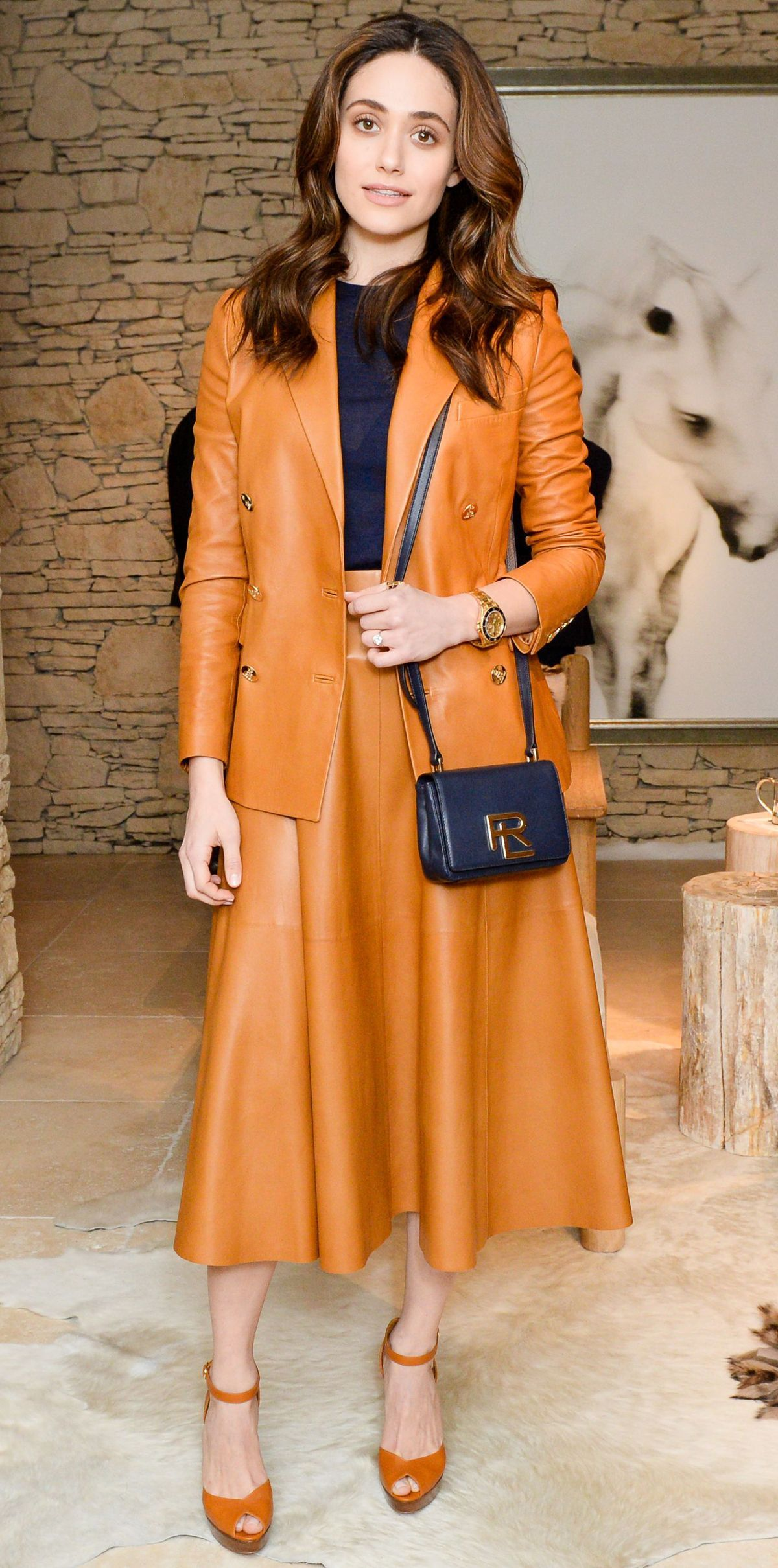 Emmy Rossum did warm-weather leather right at Ralph Lauren Home's Instagram launch. Clad in head-to-toe Ralph Lauren Collection, the star stuck to a navy-and-saffron color palette, featuring buttery leather separates, a knit top underneath, a darling cross-body, and platform sandals.