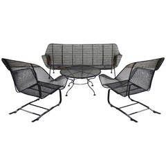 four piece suite of woodard wrought iron outdoor garden furniture