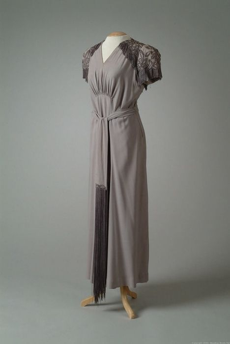 Gray Crepe Evening Gown Decorated With Heavy Dark Gray Silk Cord