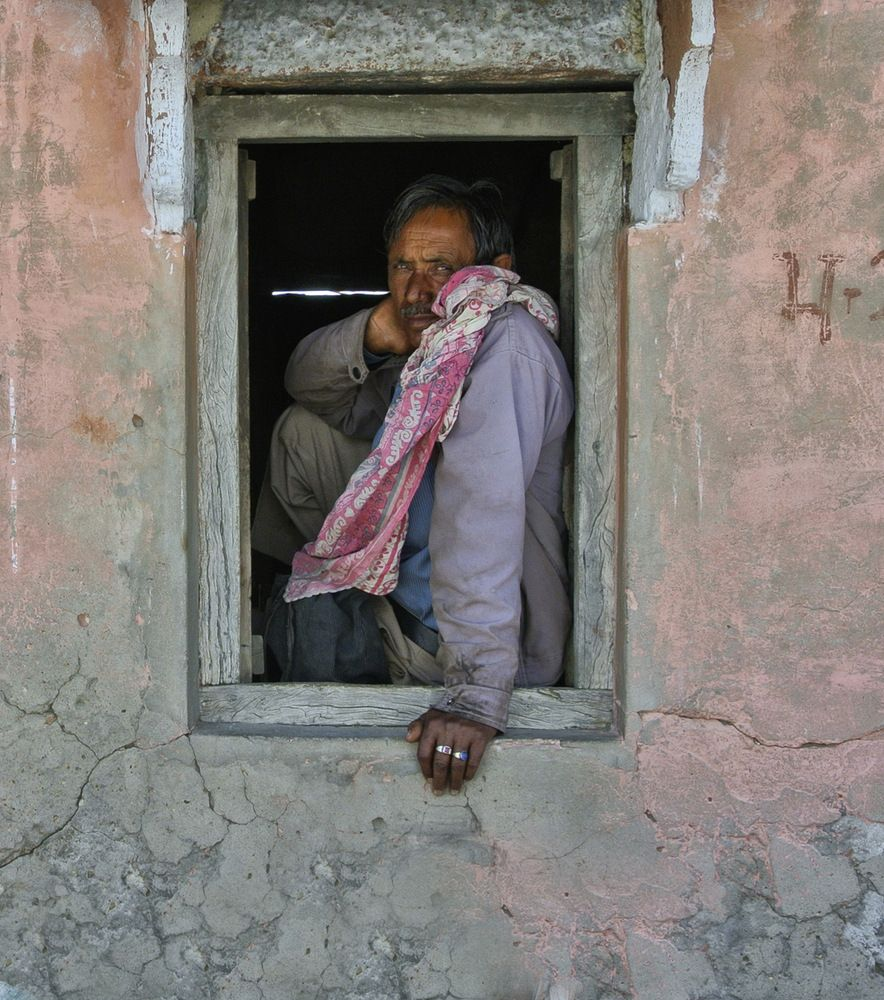 Window Sitter, He sits here waiting for his ride everyday to work in the town of Dudu in India