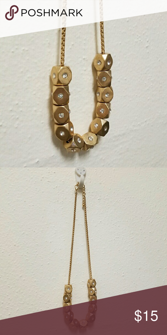 """Crystal studded gold necklace Gold colored metal necklace. Each bead has a sparkly silver crystal on each side. Excellent condition and sturdy clasp. Is a tad heavy so if you're used to wearing very thin, light necklaces you may not like the weight. Length 18"""", extension 3"""". Like new!  Bundle with other jewelry and save big! Camilla Jewelry Necklaces"""