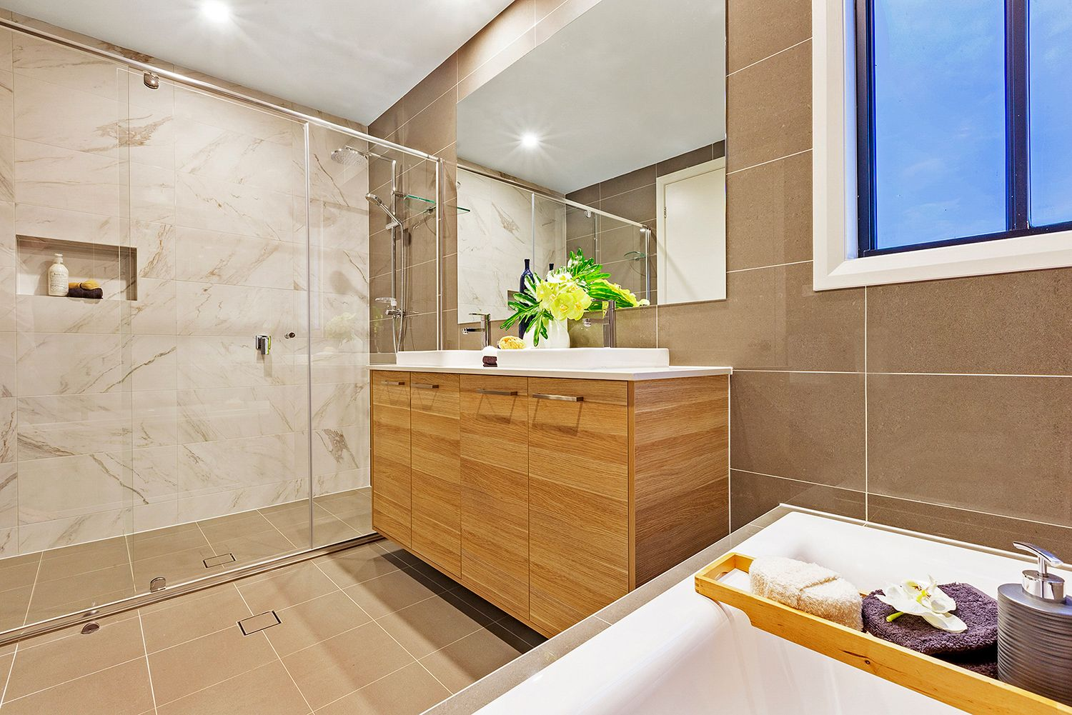 The Nova Display by Mojo Homes Sydney. A wonderful family bathroom space featuring a rail shower, double basins and bath. #MojoHomes #Caroma #Bathroom #Design #Ideas #Home #Decor #Styling #Timber #Vanity #DoubleBasins #Tiles #Inspiration #NewHome #weeklyhometrends   http://www.mojohomes.com.au/home-design/nova
