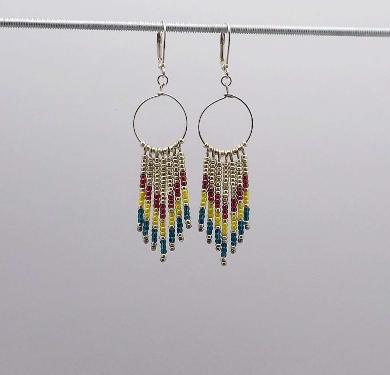 Beaded Dangle Earrings in a Chevron Design with Dark pink,Yellow, Teal beads - 3 inches long Sku:ER1012 by JewelryByKathyAbma on Etsy