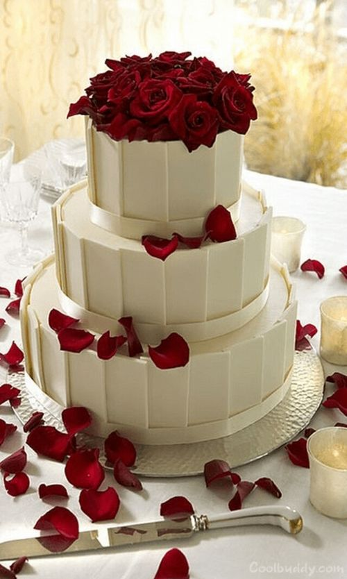 Wedding cake - simple & striking - i like the color contrast. Red against white.