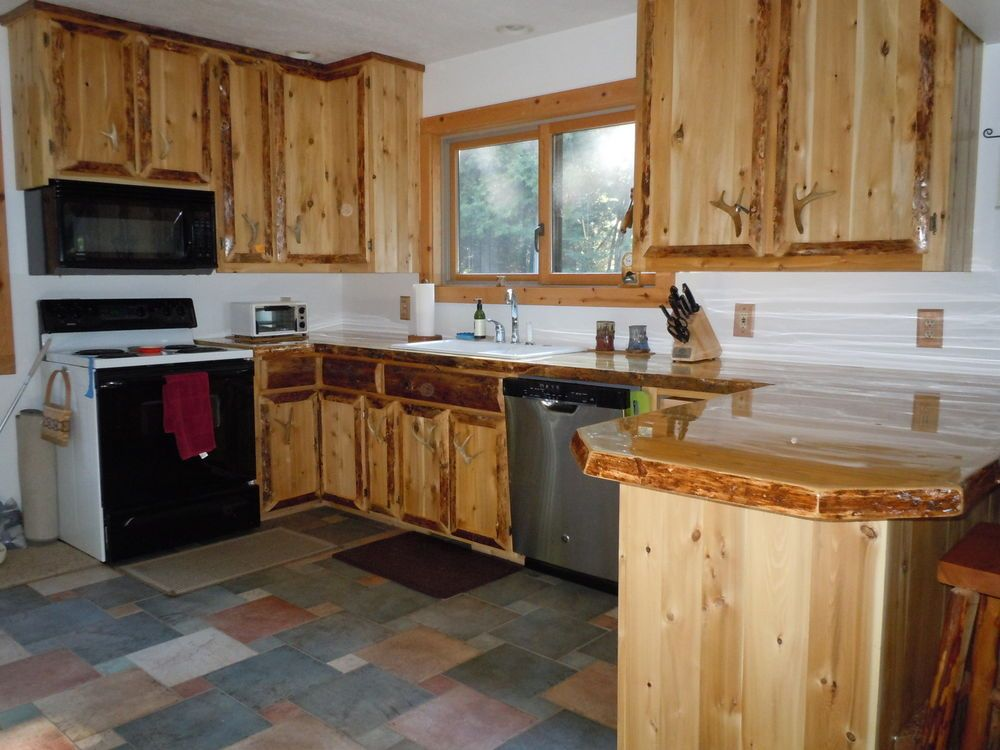 Rustic custom cedar wood kitchen cabinets wood kitchen for Custom wood cabinets