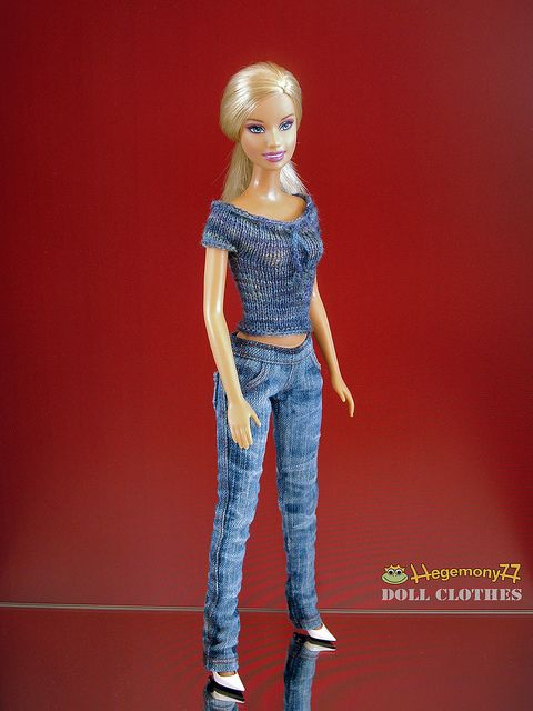 Barbie doll in worn blue jeans pants and hand knitted top