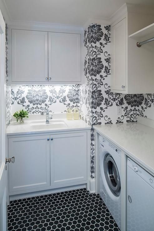 Black And White Laundry Room Features Walls Clad In Black And