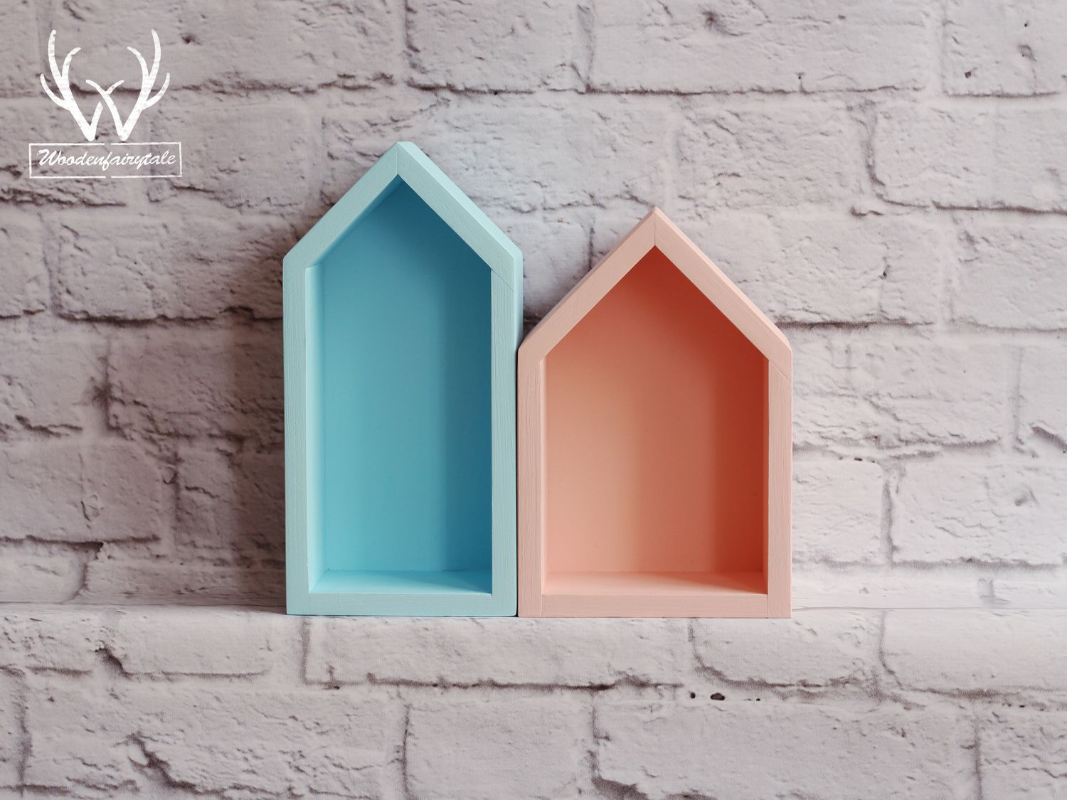 Amazing set of peachy and blue house-shaped shelves.