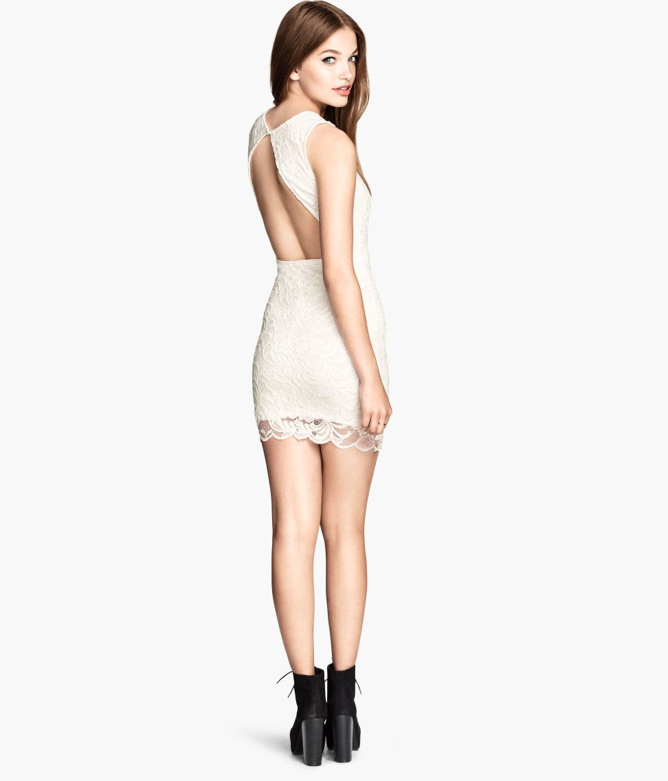 9990342c5bc3 Short, sleeveless dress in white lace. Open back with a button behind the  neck