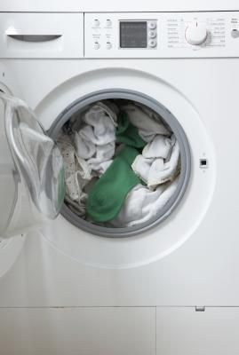 How To Fix A Washer Drain From Overflowing Front Loading Washing Machine Front Loader Washing Machine Clean Washing Machine