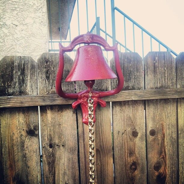 Painted an old bell I found and tied one of my wife's old gold necklace to it... (not real gold) hung it up next to the grill... DINNERS READY!!!