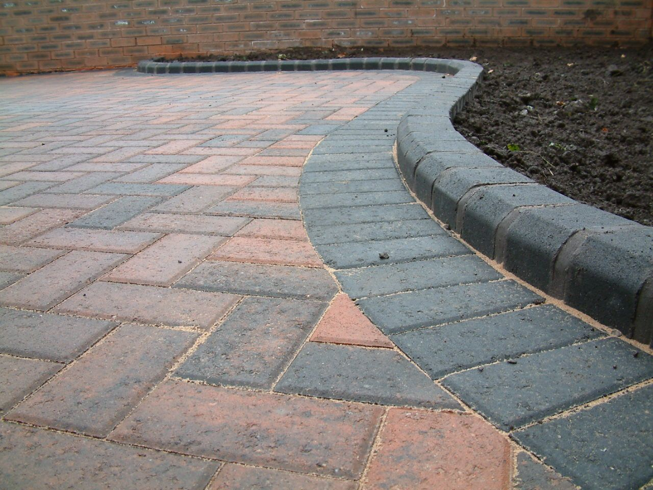 Kerbed Charcoal Brick Edging Around A Patio Brick Edging Patio