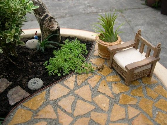 I love that there is a teeny tiny gnome for this miniature garden! Links to an etsy shop FULL of awesome fairy garden acoutrements!
