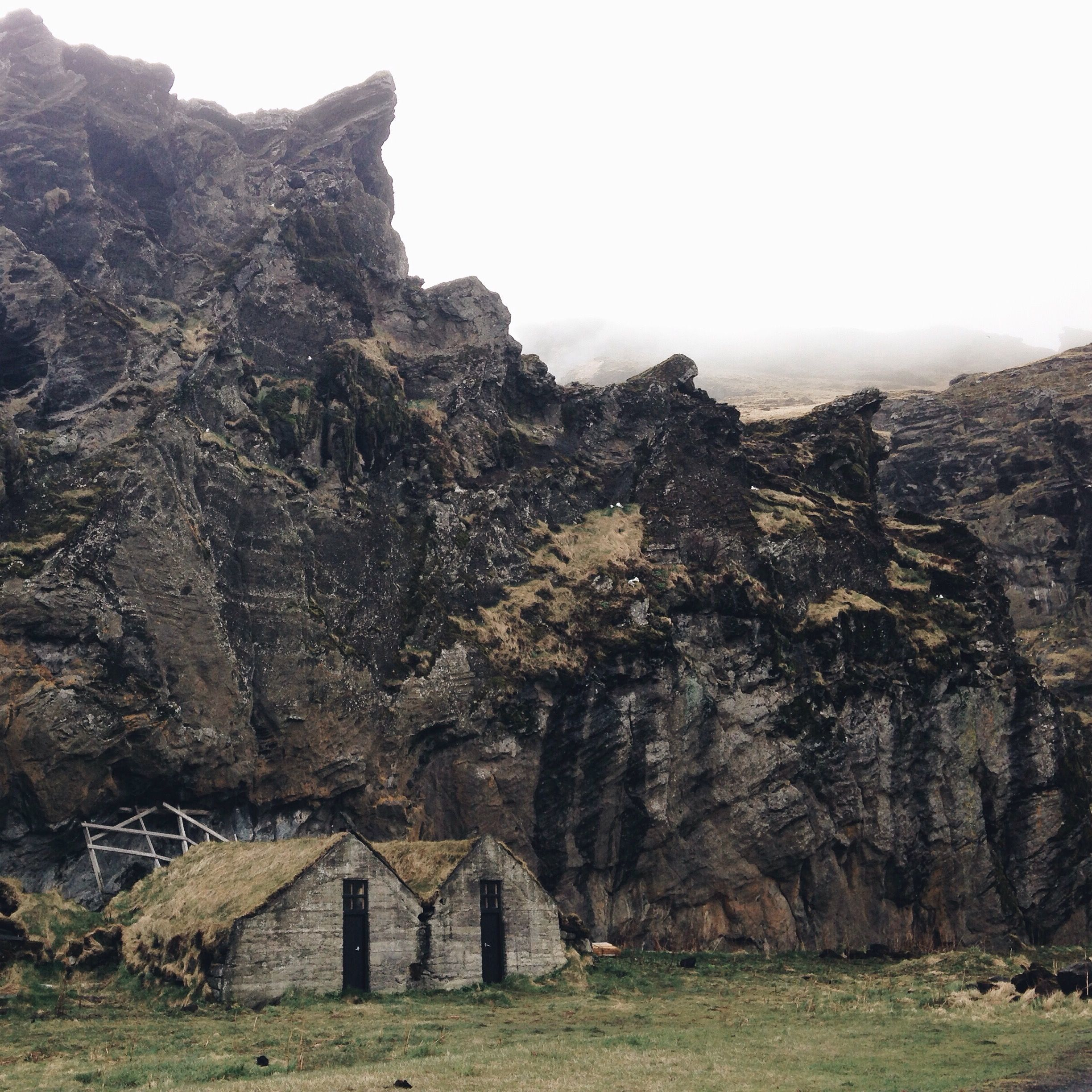 traditional Icelandic barns and homes on the main road leading by Skogar (Ring Road)