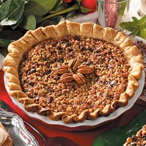 Kentucky Pecan Pie Recipe -This rich, dense pie is served at Kentucky derby parties everywhere on derby day. It features a delicious dark chocolate filling topped with plenty of toasted pecans.  —Emily Baldwin Fort Collins, Colorado