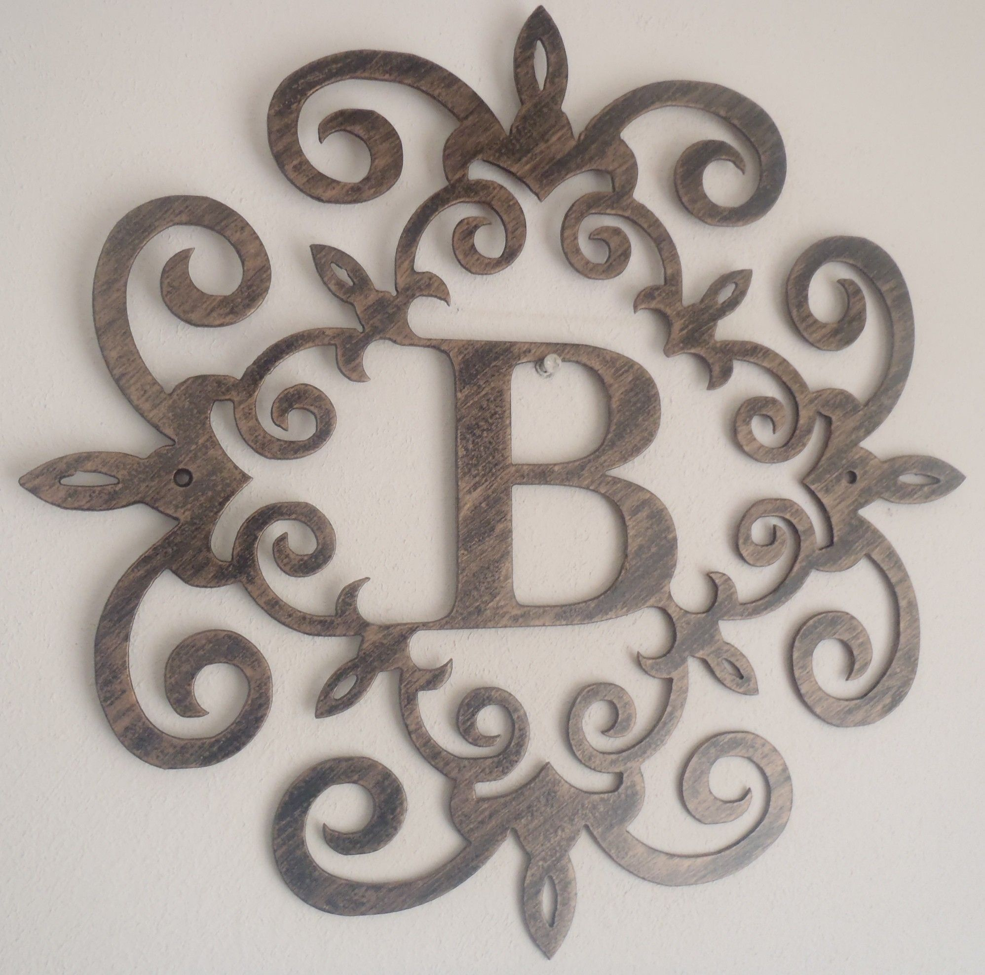 family initial monogram inside a metal scroll with b With metal wall hanging letters