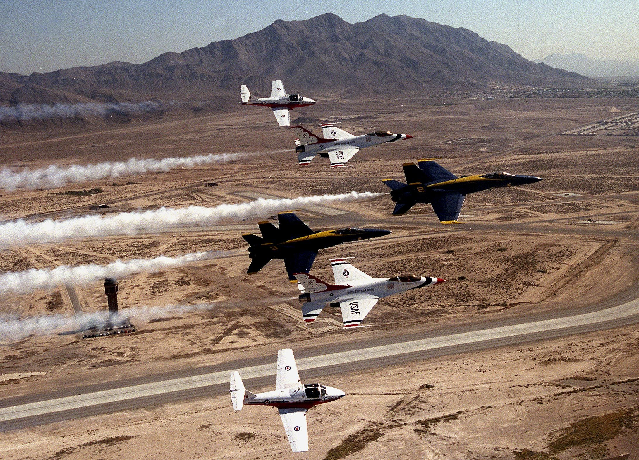 Thunderbirds and Blue Angels together...perfection ) Us