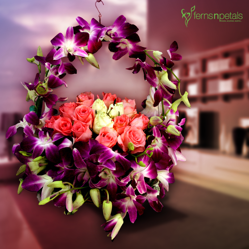 A Basket Of Best Wishes Made With Roses And Orchids For Your Loved Ones Anniversary Flowers Online Flower Delivery Flower Delivery