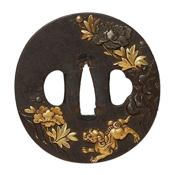 19TH/20TH CENTURY GILT BRONZE TSUBA MEIJI PERIOD Featuring prancing Shishi in Gold Taka-zogan relief amongst silver and gold flower motifs 8 x 8.5 x 0.5cm.