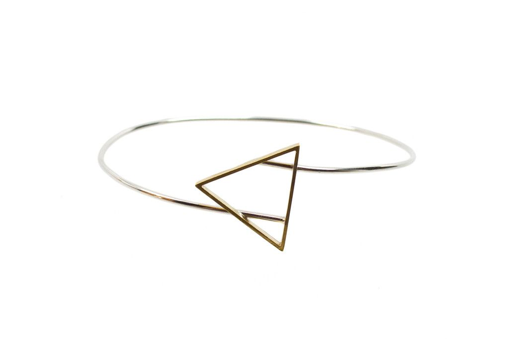 A brass triangle hovers over the flowing lines of sterling silver. This Georgie Bangle looks lovely pushed up and worn mid-arm. $60 www.mooreaseal.com