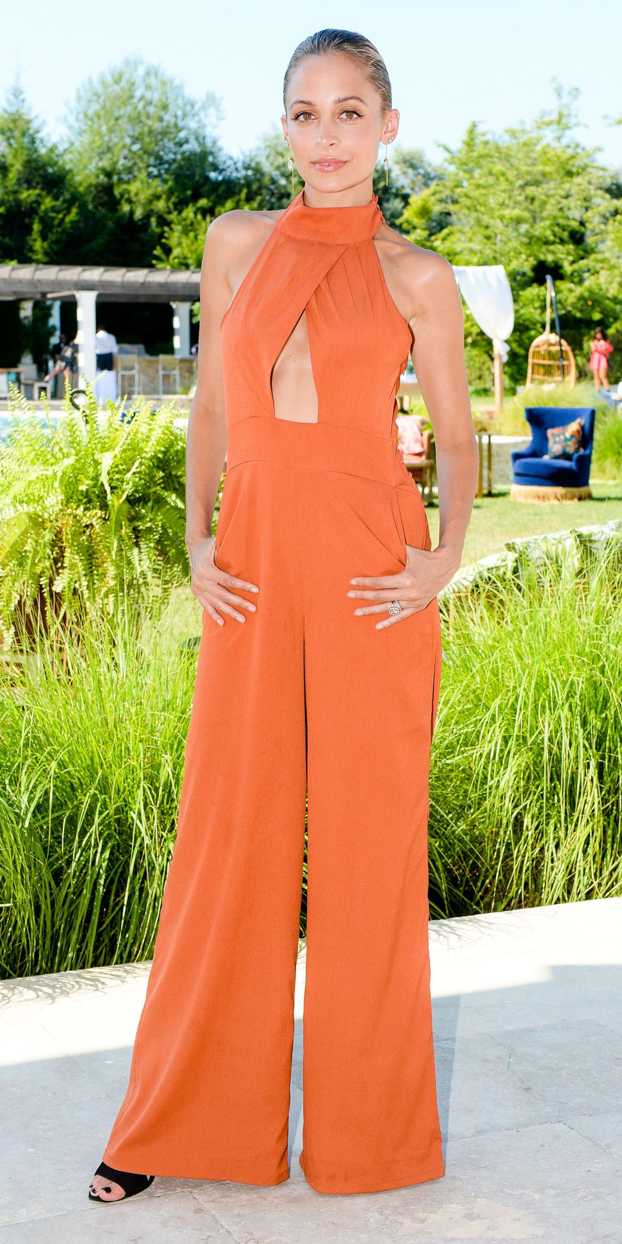 9e8ebe42f49 While Nicole Richie s burnt orange jumpsuit could totally work for an  evening out