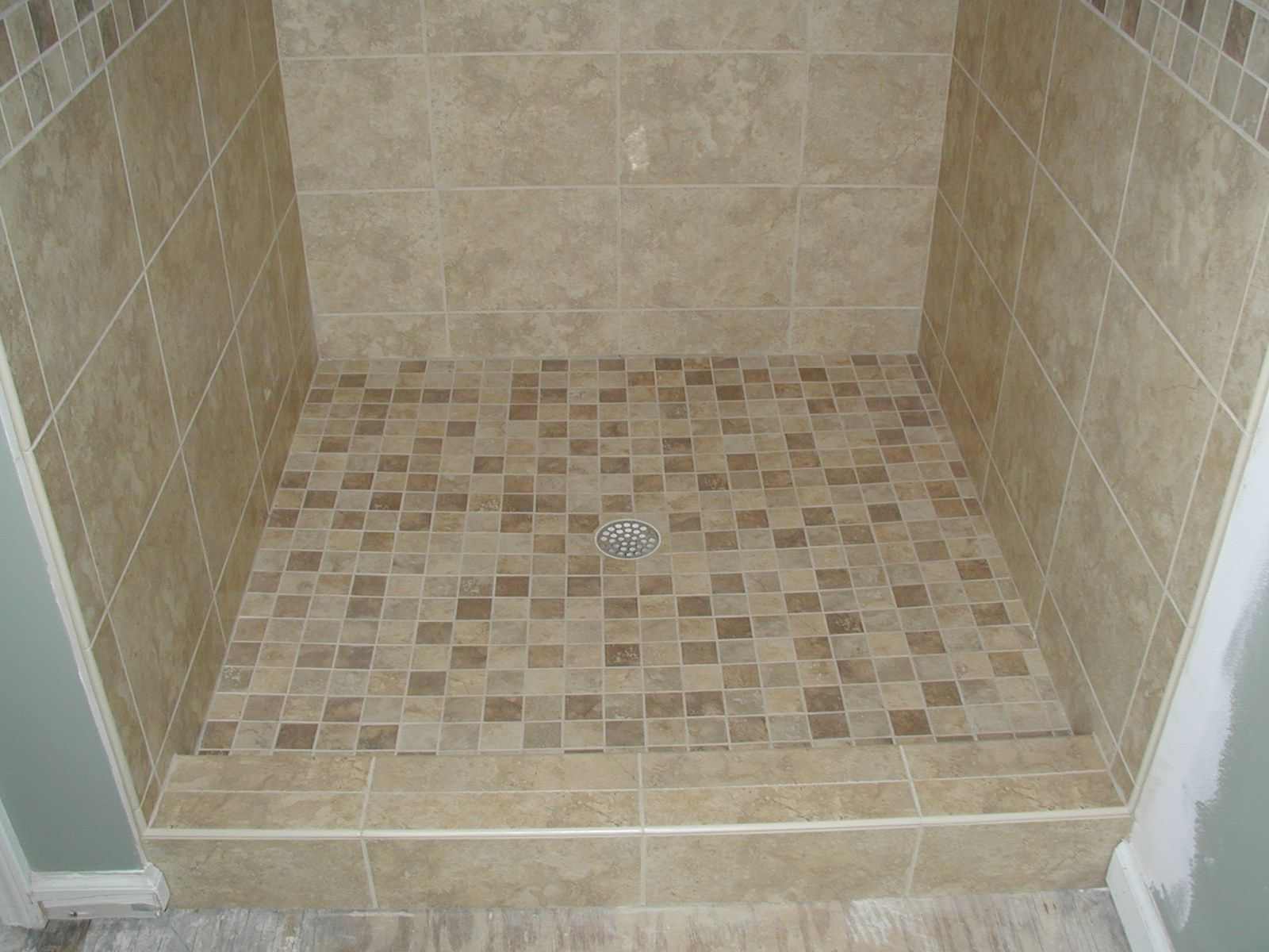 Bathroom tile showers with half wall of glass tiled shower marvelous how to tile a shower floor with river rock and how much does it cost to tile a shower floor dailygadgetfo Image collections