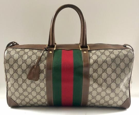 Save 90% on the Gucci Brown Gg Supreme Canvas   Leather Weekend Travel Bag!  This travel bag is a top 10 member favorite on Tradesy. cf3a7a5f2a9ff